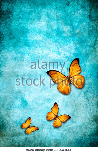 three butterflies on a blue grunge background - Stock Image