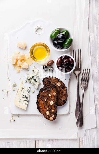 Cheese appetizer with honey and fruit bread - Stock Image