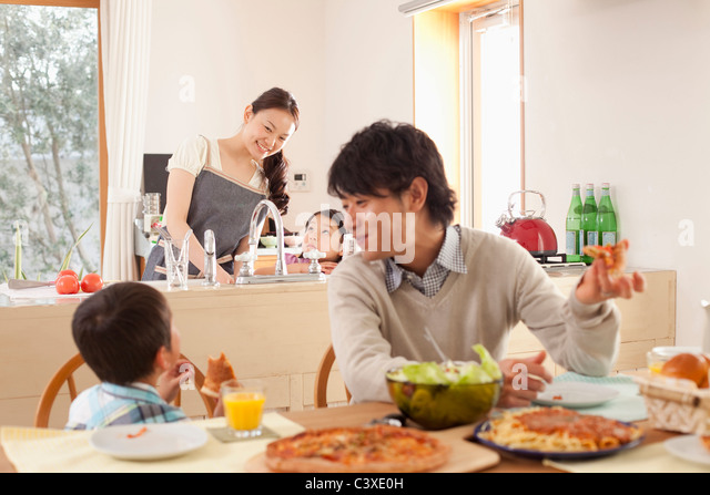 Family of Four Having Lunch - Stock Image