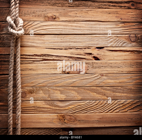 Image of old texture of wooden boards with ship rope. - Stock Image