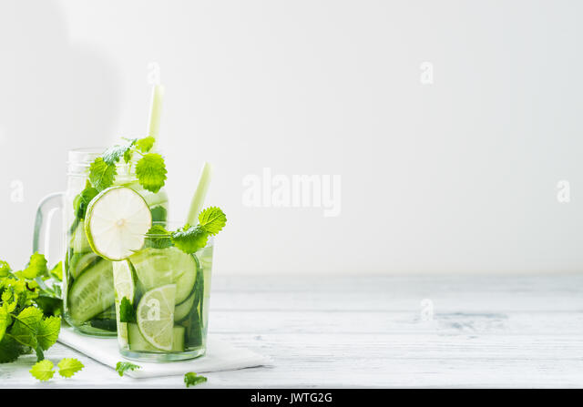 Refreshing drink with cucumber, lime, mint. Detox concept. White background. Copy space - Stock Image