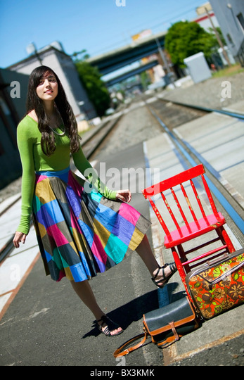 Teenage Girl Waiting For The Train In Downtown: Portland, Oregon, United States Of America - Stock Image