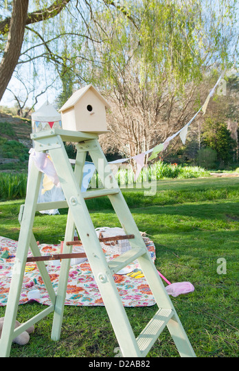 Picnic blanket and bunting outdoors - Stock Image
