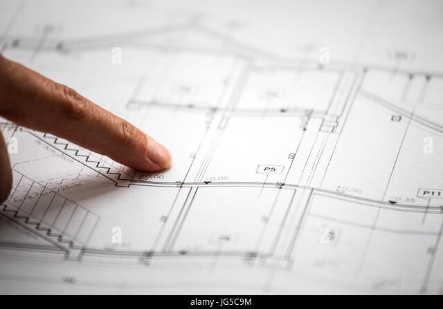 Pointing to specific place on architectural sketches of new house - Stock Image