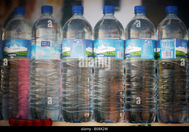 Bottled water for sale in beach hut Spain - Stock Image