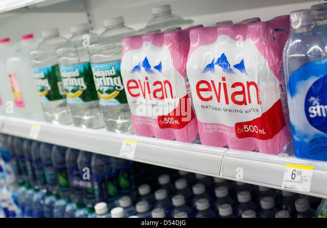 Evian and Poland Spring bottled water on display at a Walgreens Flagship store. - Stock Image