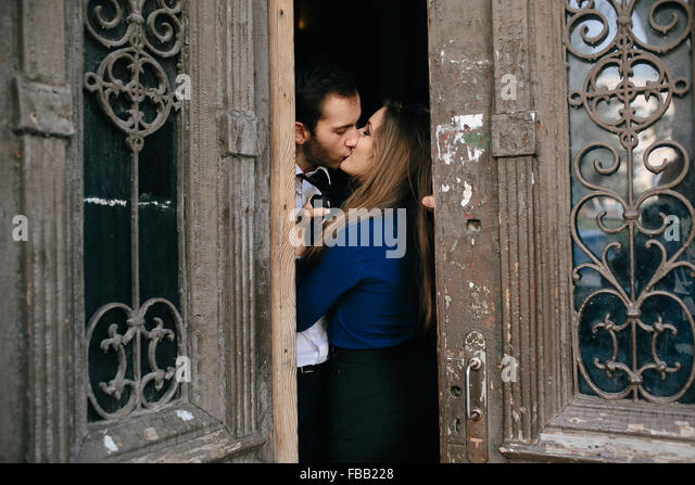 man and woman posing in door - Stock Image