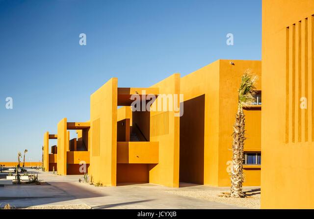 Perspective of sunlit exterior facade. Laayoune Technology School, Laayoune, Morocco. Architect: Saad El Kabbaj, - Stock-Bilder