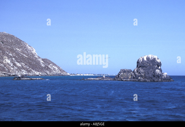 Los Roques Archipelago Venezuela Gran Roque rocky shoreline seen from water - Stock Image