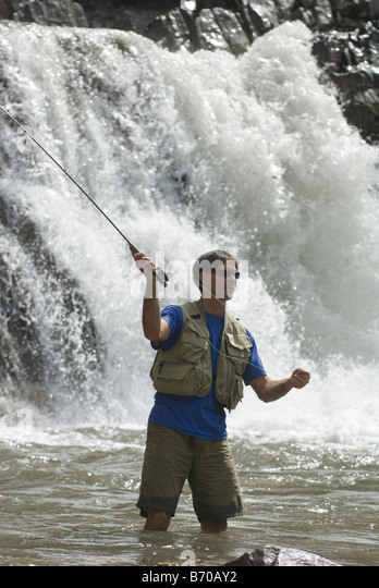 Man fly fishing below Crystal Falls, Marble, Colorado. - Stock Image