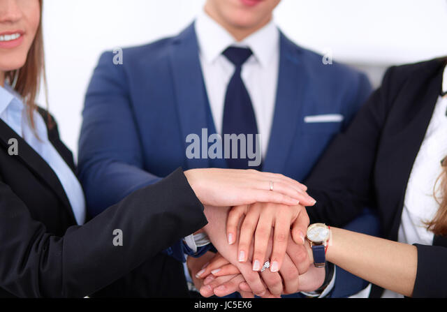 Business people group joining hands and representing concept of friendship and teamwork - Stock Image