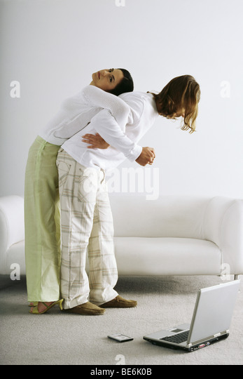 Man attempting and failing to lift woman on back - Stock Image