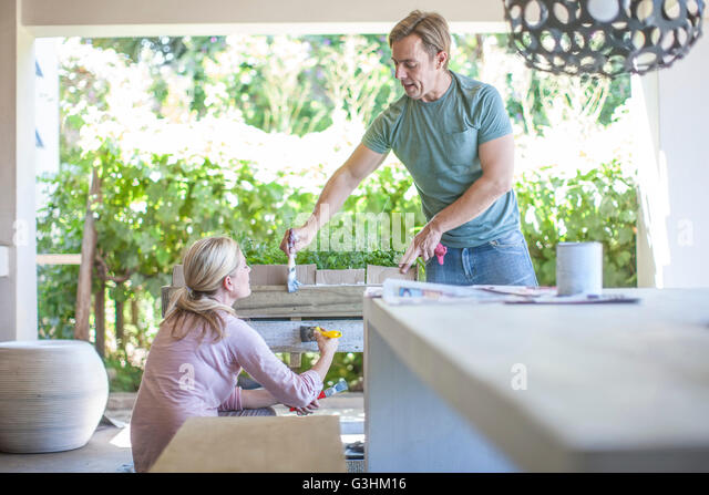 Couple doing DIY together - Stock Image