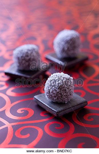 Coconut dark chocolate trufles - Stock Image