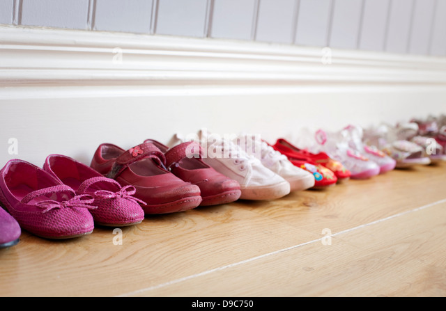 Child's shoes in a row - Stock-Bilder