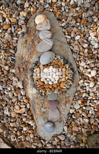 pebbles  arranged on a rock - Stock-Bilder