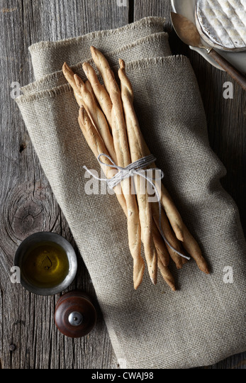 Breadsticks tied with string - Stock Image