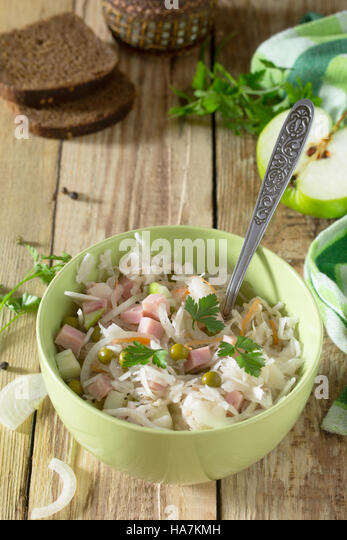 Salad with cabbage, chicken, apple, cucumber and walnuts. Healthy food concept. Top view. - Stock Image