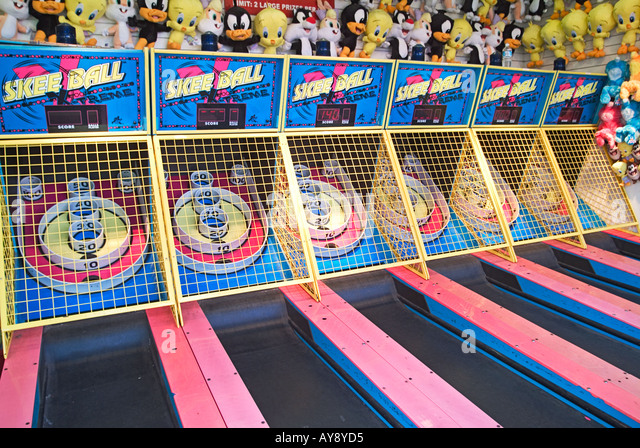 Santa Monica California, pier games, boardwalk skee ball, skeeball, bowling, outdoors, adult, child, children, recreation - Stock Image