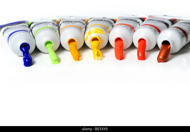 Multicolor tubes of paint over a white background - Stock Image