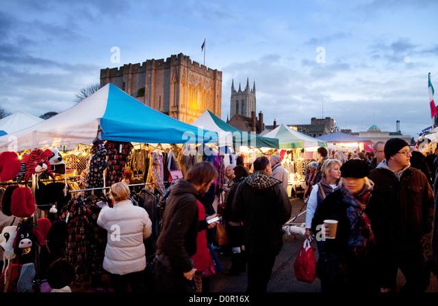 People enjoying Bury St Edmunds Christmas market, Suffolk England  UK - Stock Image