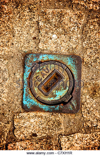 Manhole covers in a road - Stock-Bilder