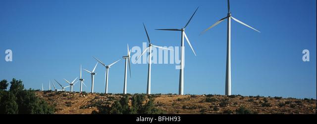 Row of wind turbines in desert - Stock-Bilder