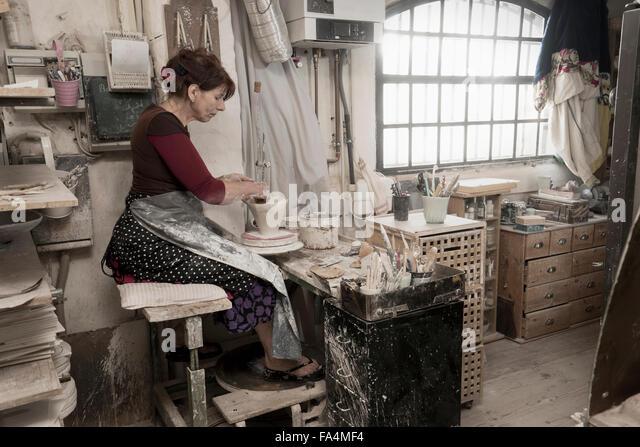 Female potter moulding clay in workshop, Bavaria, Germany - Stock Image