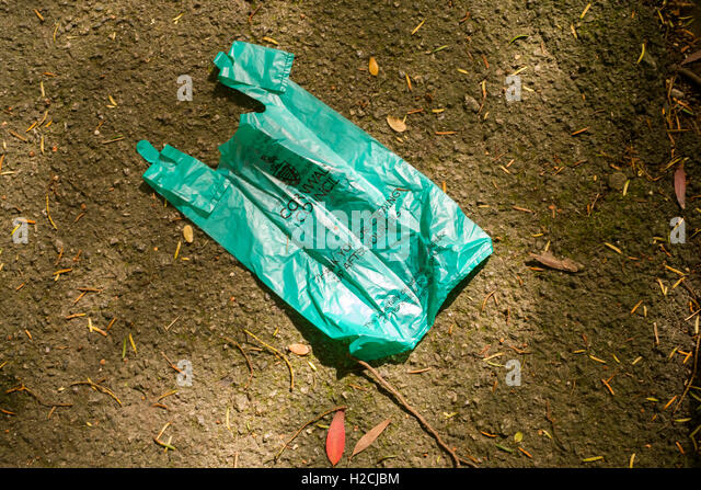 Cornwall Council issued dog waste bag left discarded on pavement in Falmouth, Cornwall - Stock Image