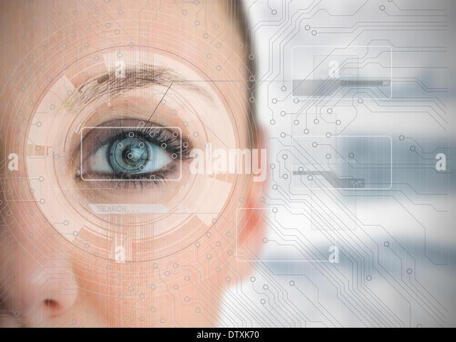 Close up of woman eye analyzing charts - Stock Image