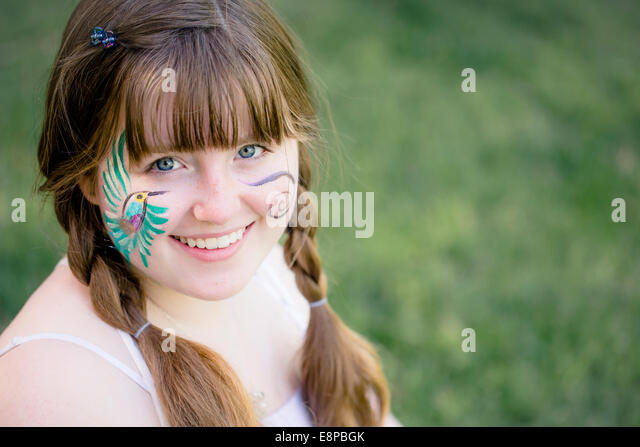 Girl (10-12) with painted face - Stock-Bilder