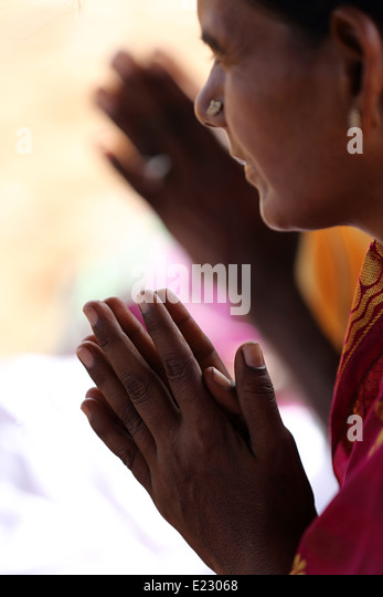 Indian woman in prayer Andhra Pradesh India - Stock-Bilder