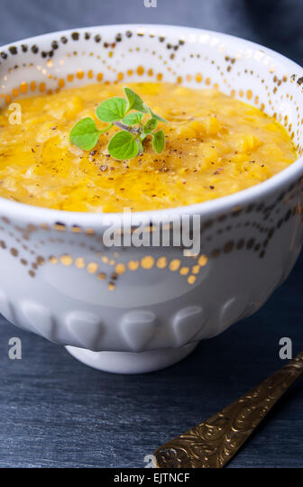 A Close Up View of a Bowl of Vegan Red Lentil Soup. - Stock Image