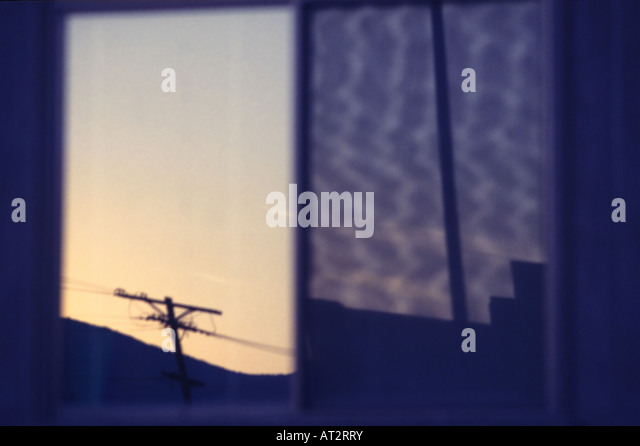 abstract reflection of telephone pole in horizontal window - Stock Image