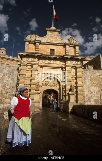Malta Mdina city gate walled city former capital female resident traditional costume - Stock Image
