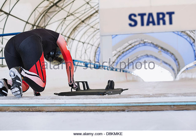 Female skeleton athlete preparing for race - Stock Image