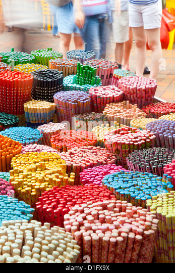 Colourful decorative chopsticks for sale as souvenirs to tourists in Chinatown market, Temple Street, Singapore, - Stock Image