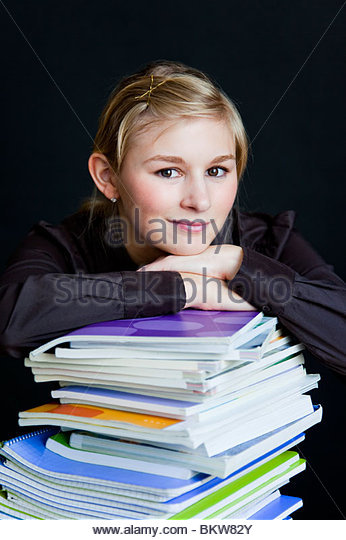 Young girl with books - Stock Image
