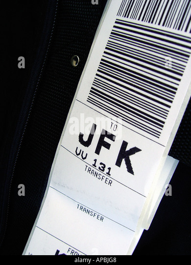 Closeup of a Luggage Tag enroute to John F Kennedy Airport in New York City Copy Space - Stock Image