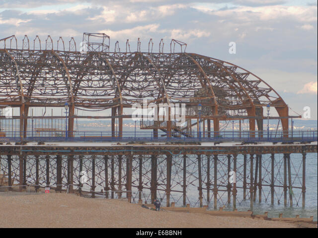 Eastbourne, East Sussex, UK. 19th August, 2014. A workman has died whilst working on Eastbournes fire damaged pier - Stock Image
