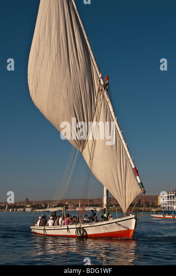 Felucca traditional wooden sailboat portrait on Nile River Aswan Egypt profile lateen sail sailing boat - Stock Image