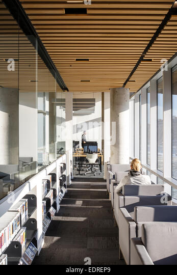 The Bibliothèque du Boisé, Montreal, Canada. Architect: Lemay Architectes, 2013. Several reading and study - Stock Image