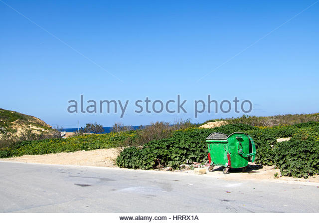 General Metal Waste bin at the ocean road of Marsalforn, Malta, an open household waste container - Stock Image