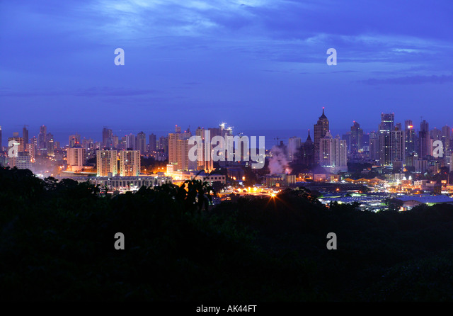 Panama city at night seen from the hill in Metropolitan park, Panama province, Republic of Panama. November 2007. - Stock Image
