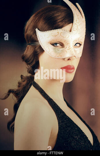 Beautiful masked brunette woman - Stock-Bilder