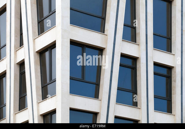 Modern architecture abstract fragment with white walls and windows - Stock Image