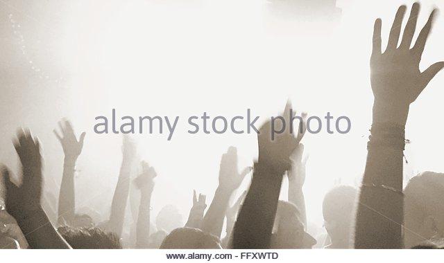 Close-Up Of Raising Hands In An Event - Stock-Bilder