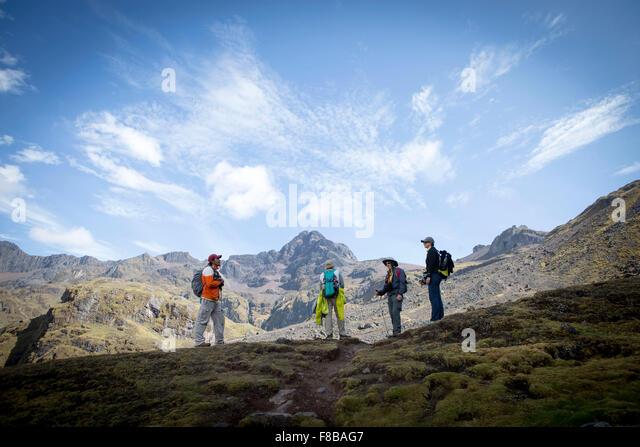 The Lares District of Peru. Tourists on a trek take a break - Stock Image