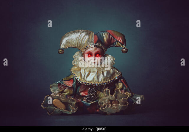 Scary clown doll with demonic eyes . Horror and halloween - Stock-Bilder