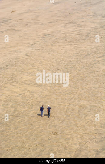 Tourists on Newquay's Fistral Beach in summer sunshine. - Stock Image
